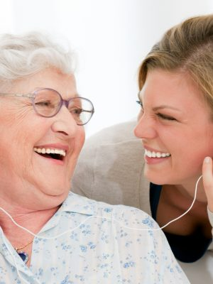 Caregiver Enjoying Music With Senior